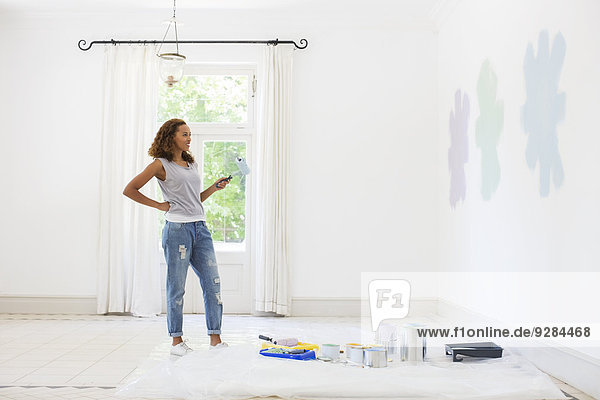 Woman observing paint swatches