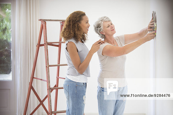 Two women deciding on wall color together
