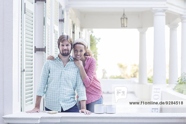 Couple hugging on porch