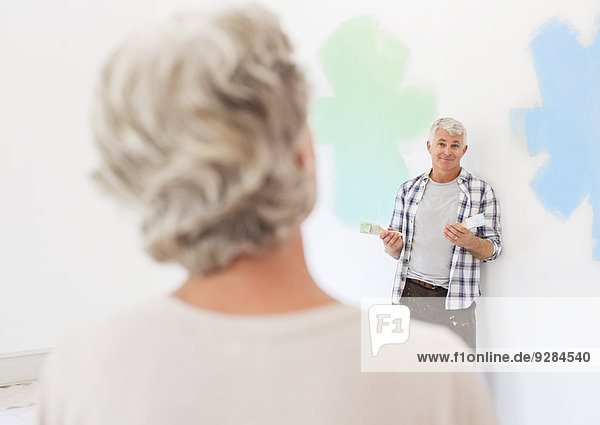 Older couple deciding on paint colors together