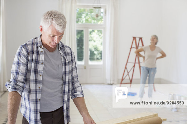 Older couple observing new living space