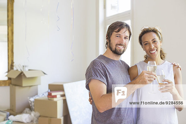 Couple celebrating with drinks