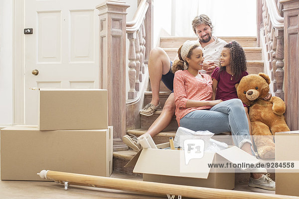 Family talking on stairs together