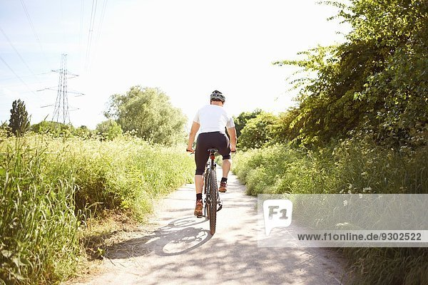 Cyclist cycling on path