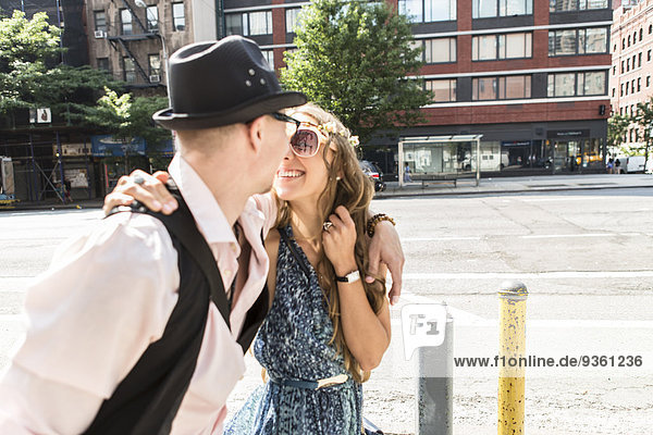 Funky couple in street  New York City  US