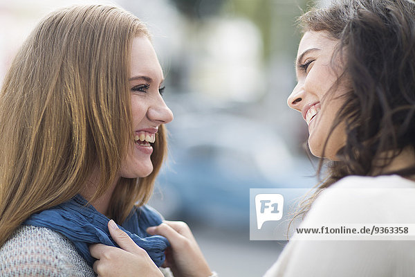 Two laughing female friends