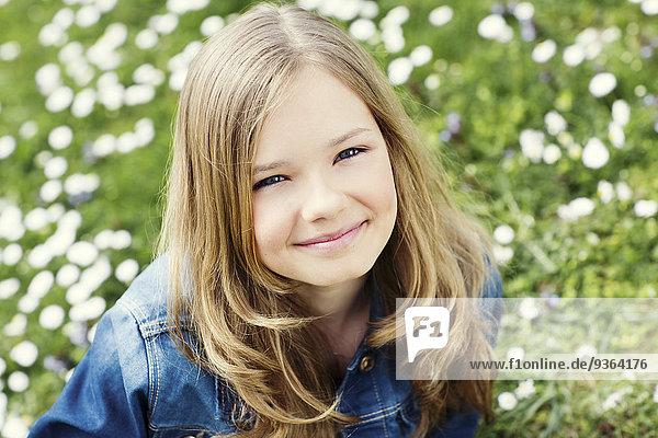 Portrait of smiling girl on flower meadow