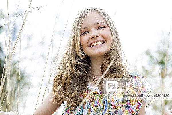 Portrait of smiling girl wearing summer dress