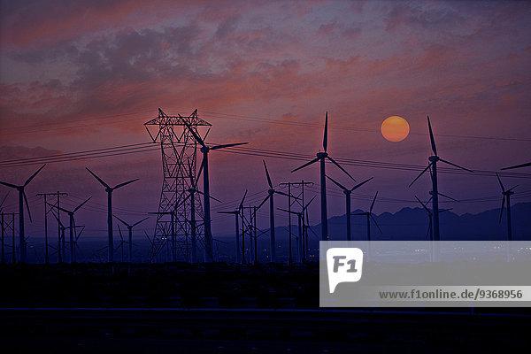 Windturbine Windrad Windräder Sonnenuntergang Silhouette Stärke