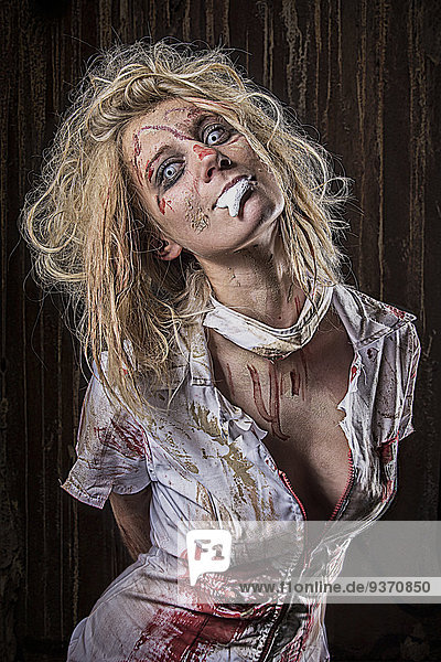 Spooky blond young woman