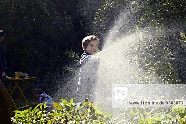 Two Children Gardening  Munich  Bavaria  Germany