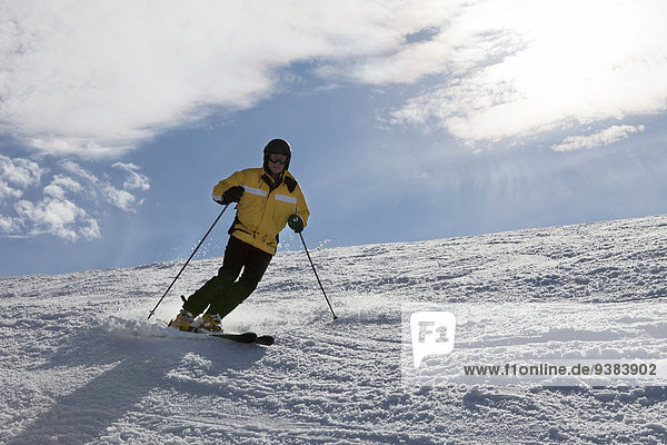 Young woman skiing downhill  Sudelfeld  Bavaria  Germany