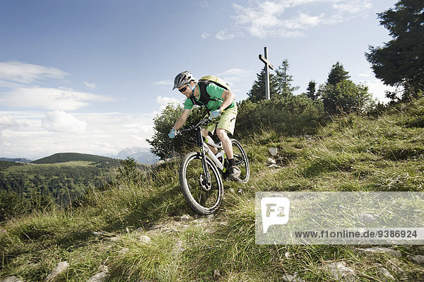 Mountain biker riding downhill  Samerberg  Germany