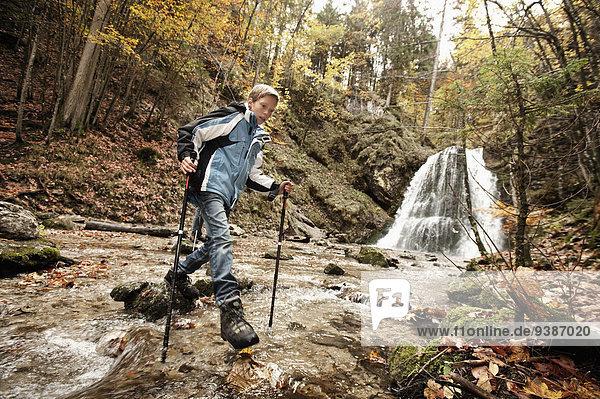 Boy Crossing Brook  Bavaria  Germany  Europe