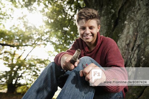 Teenage boy carving wood  Bavaria  Germany  Europe