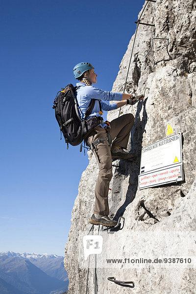 Female alpinist rock climbing  Innsbruck route  Tyrol  Austria