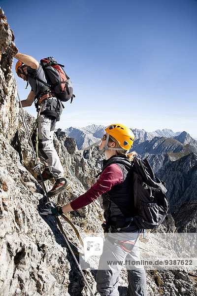 Two alpinists rock climbing  Innsbruck route  Tyrol  Austria