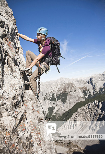 Female alpinist rock climbing  Innsbruck route  Austria