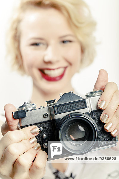 Young Woman Using Photo Camera