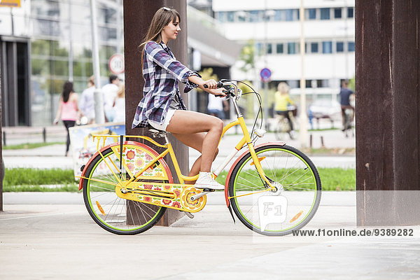 Young woman riding bicycle  Osijek  Croatia