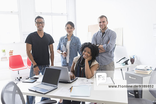 Women and men working in office