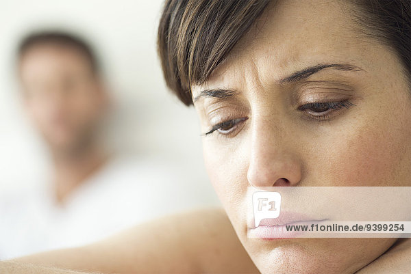Woman contemplative and withdrawn after disagreement with husband