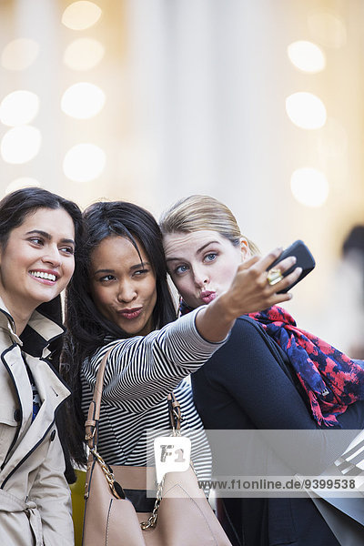 Women taking cell phone picture together