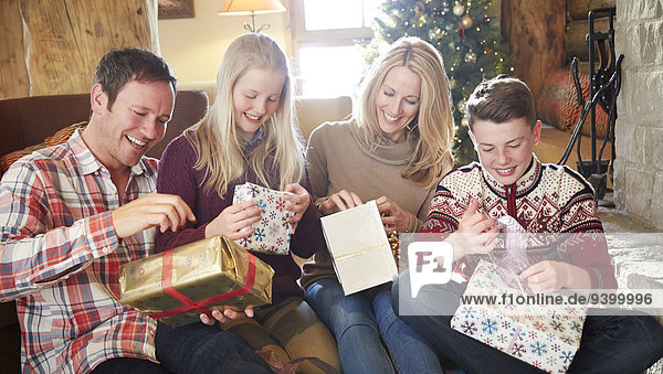 Family opening gifts on Christmas