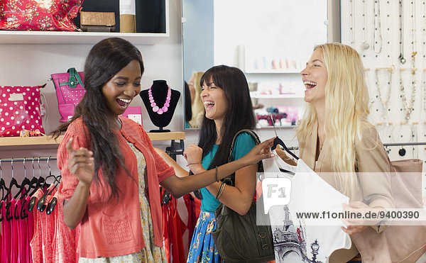 Women shopping together in clothing store