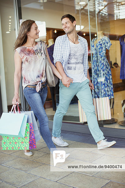 Couple shopping together in shopping mall