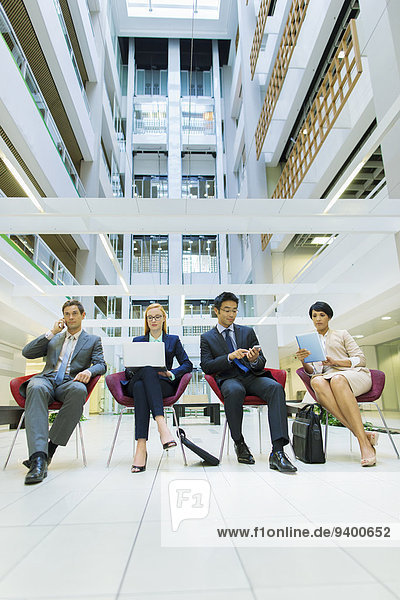 Business people sitting in office building