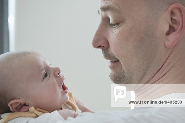 Father and baby boy communicate with each other  close up