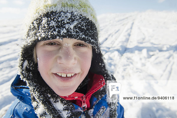 Portrait of boy in snow  smiling