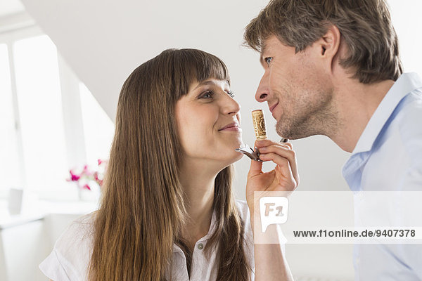 Couple smelling wine cork  smiling