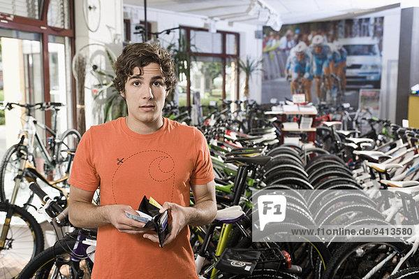 Young man buying bicycle