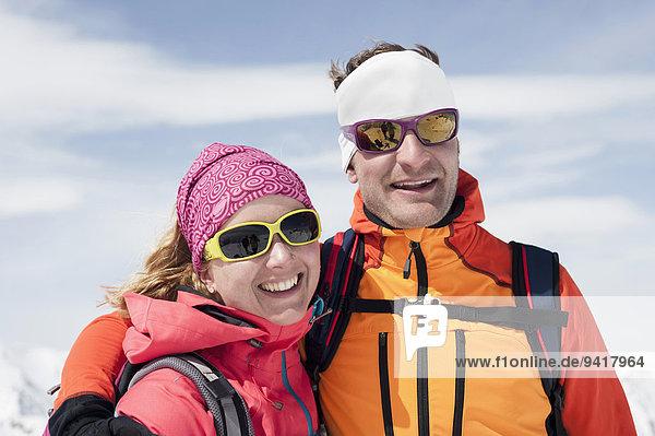 Portrait Skibrille Winter lächeln Schutzbrille Ski
