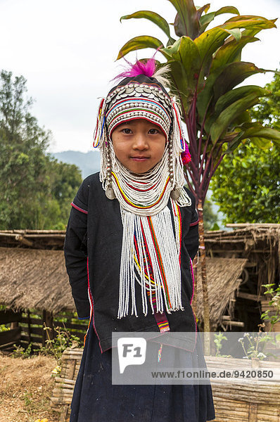Traditionally dressed girl from the Akha people  hill tribe  ethnic minority  Chiang Rai Province  Northern Thailand  Thailand