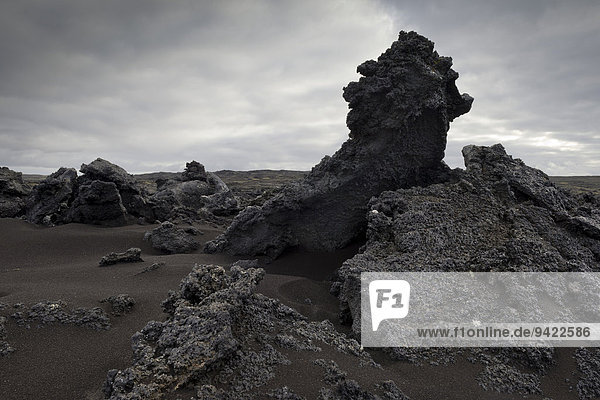 Black sand and piled up lava  Reykjanesskagi  Southern Peninsula or Reykjanes  Iceland
