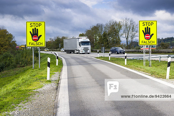 Two German signposts indicating not to enter the highway in the wrong direction  Passau  Bavaria  Germany