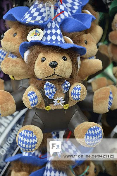 Teddybären in Tracht an einem Verkaufsstand  Oktoberfest  München  Oberbayern  Bayern  Deutschland