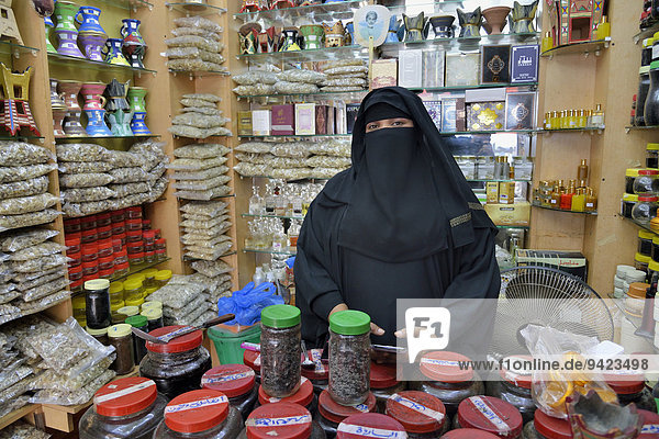 Incense seller at her booth on the incense market  Salalah  Dhofar Region  Orient  Oman