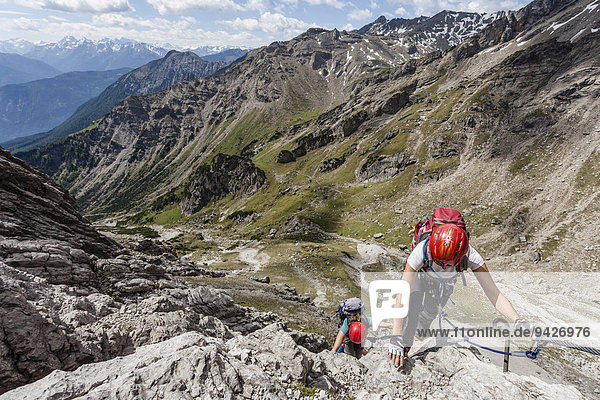 Mountaineers at the Imst via ferrata during the ascent of Mt Maldenkopf in the Lechtal Alps  at the back Mt Vorderes Alpjoch  Hoch-Imst  Imst  Tyrol  Austria