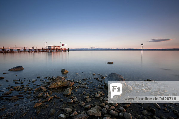 Evening mood on the jetty with view on Mt. Saentis in the Swiss Alps  Lake Constance  Hagnau  Baden-Wuerttemberg  Germany  Europe