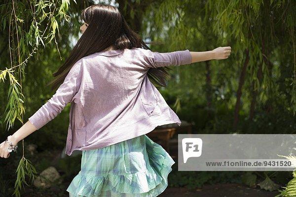 Woman dancing in garden