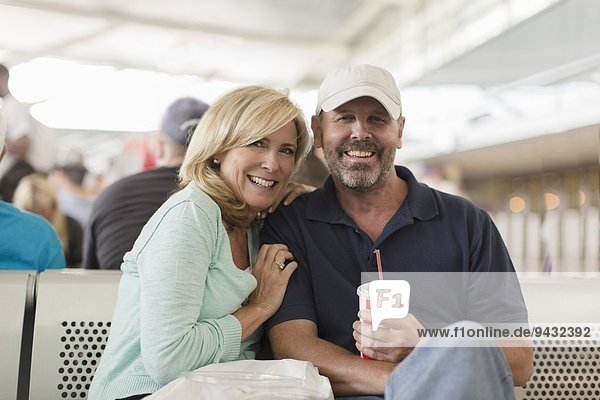 Mature couple on passenger ferry  smiling