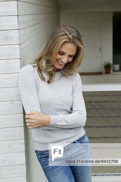 Mature woman with arms folded  smiling