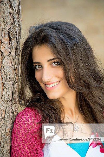 Beautiful young woman smiling outdoors.