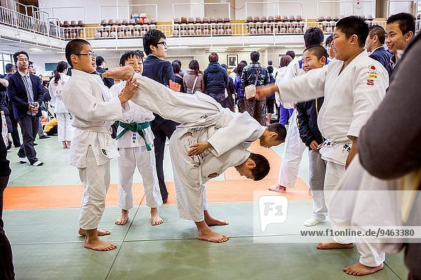 After finishing the ceremony  Judo exhibition during the ritual of kagami biraki  breaking the rice cake Kagamimochi  decoration of the Japanese New Year every year on January 11  in Kodokan judo school  Tokyo  Japan.