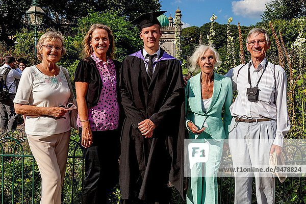 A Graduating Student From The University of Brighton Poses For Photographs With His Family In Grounds Of The Royal Pavilion  Brighton  England.