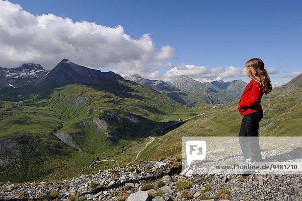little girl admiring the scenery  Little St Bernard Pass  Savoie department  Rhone-Alpes region  France  France-Italy border  Europe.